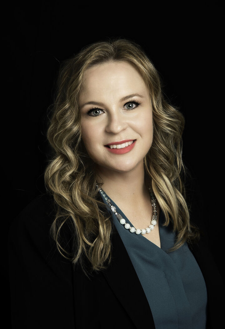 Emily McDonell,  in Lutz, Dennis Realty & Investment Corp.